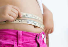 Cute girl measuring her stomach Stock Photo