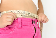 Cute girl measuring her stomach Stock Image
