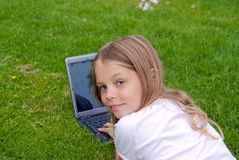 Cute girl with modern laptop Royalty Free Stock Photography