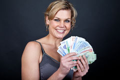 Cute girl with money bank notes Royalty Free Stock Image