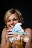 Cute girl with money bank notes Royalty Free Stock Images