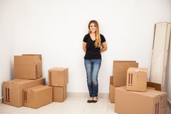 Cute girl moving into her new home Royalty Free Stock Image