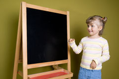 Cute  girl near blackboard Stock Photos