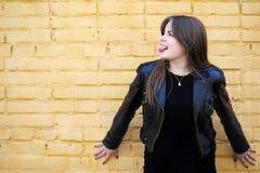 Cute girl near a brick wall Stock Photo