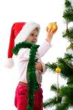 Cute girl near the christmas tree. Little girl near the christmas tree on white background Stock Photography