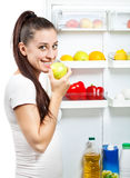 Cute girl near the open refrigerator Royalty Free Stock Photos