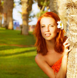 Cute girl near palm tree Stock Image