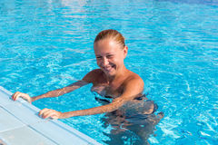 Cute girl near pool Royalty Free Stock Photos
