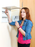 Cute girl near power control panel Royalty Free Stock Images