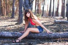 Cute girl near sandy mountain Royalty Free Stock Photography