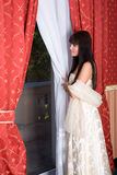 Cute girl near the window Royalty Free Stock Photos