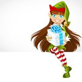 Cute girl the New Year's elf give a gift and sit on banner Stock Photos