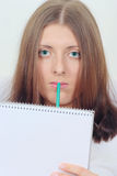 Cute girl with notebook and pencil. Portrait of the clever girl with a notebook and a pencil removed close up Stock Photo