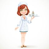 Cute girl nurse in white medical coat with a tray with a glases Stock Photos
