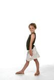 Cute girl with one leg in front. Side view of cute girl with one leg in front as if walking Stock Image