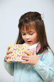 Cute girl opening gift box Royalty Free Stock Photography