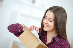 Cute girl opening package Royalty Free Stock Image