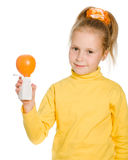 Cute girl with orange and bottle Royalty Free Stock Photo