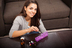 Cute girl organizing pills Royalty Free Stock Photos