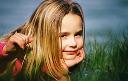 Cute girl outdoors. A portrait of a cute little girl with a beautiful smile outdoors Stock Photography