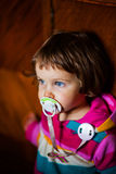Cute girl with pacifier Royalty Free Stock Image