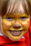 Cute girl with painted face. She is so proud Royalty Free Stock Photos