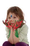Cute girl with painted hands and face Stock Photos
