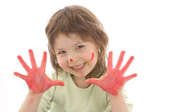 Cute girl with painted hands and face Stock Images