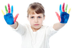 Cute girl with painted hands Stock Photo
