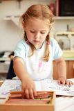 Cute girl painting Stock Image