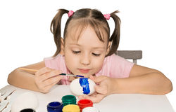 Cute girl painting easter eggs Stock Image