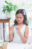Cute girl painting easter eggs Royalty Free Stock Photos