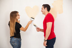 Cute girl painting a heart Stock Image