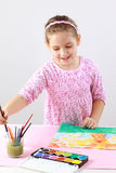 Cute girl painting with watercolor Stock Photography