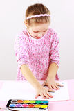 Cute girl painting with watercolor Stock Image
