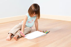 Cute girl paints with pen Royalty Free Stock Photo