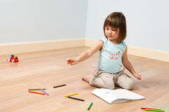 Cute girl paints with pen Stock Photo
