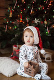 Cute girl in pajamas and christmas hat Royalty Free Stock Photo