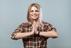Cute girl with palms together Royalty Free Stock Images