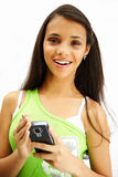 Cute girl with palmtop. Beautiful teenage girl happy with her PDA Royalty Free Stock Photos