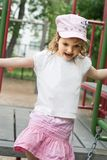 Cute girl palying on the playground Royalty Free Stock Image