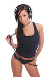 Cute girl in panties and a shirt with a headphones Royalty Free Stock Photos