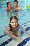 Cute Girl With Parents In Pool Royalty Free Stock Image