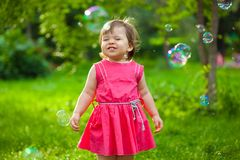 Cute girl at park with bubbles Royalty Free Stock Images