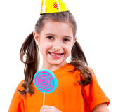 Cute girl in party hat with colored candy. Stock Image