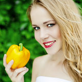 Cute girl with pepper Stock Images