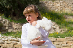 Cute girl with pet rabbit Stock Photos