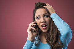 Cute girl on the phone Royalty Free Stock Photos