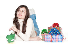 Cute girl between piggy bank and presents Stock Photography