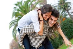 Cute girl piggybacking on boyfriend. Stock Images